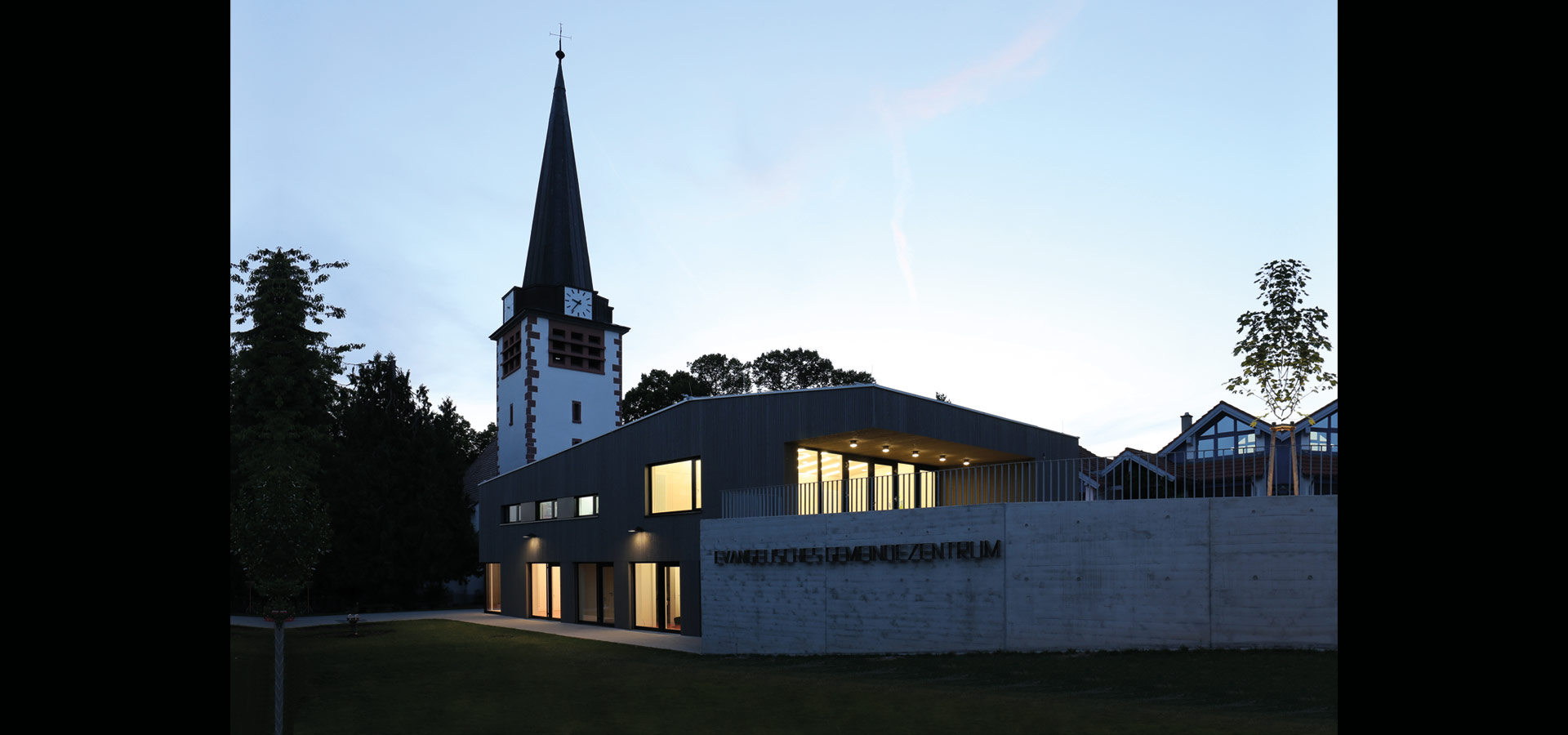 Luxsystem led luminaire lines of light community hall huchenfeld from outside