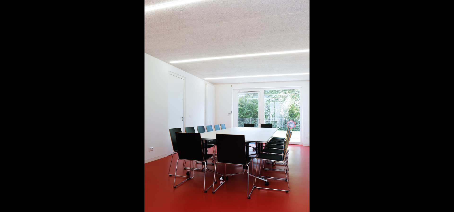Luxsystem led luminaire lines of light community hall huchenfeld public spaces