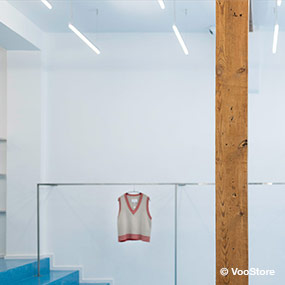 LED Pendant luminaires combined with wood shop lighting VooStore Berlin from Luxsystem
